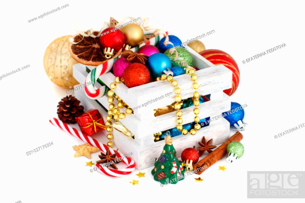 Stock Photo: Christmas composition with spices and ornaments on white.