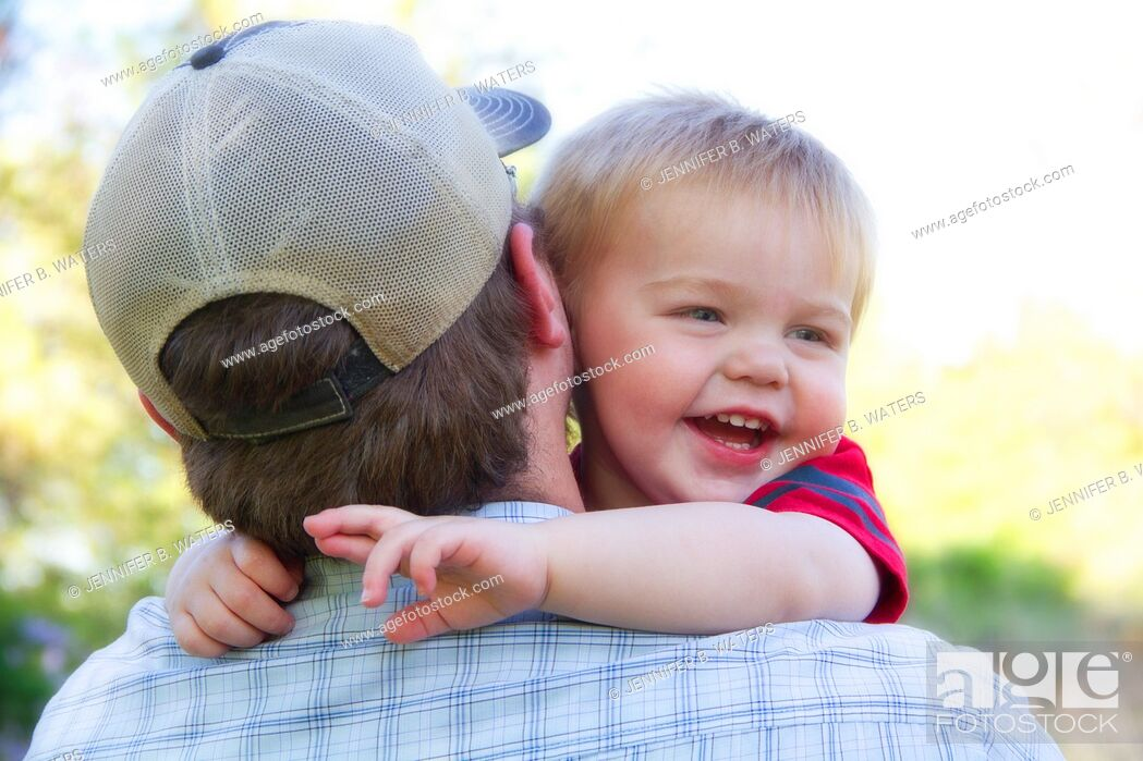 Stock Photo: A man holding his young son outdoors in Spokane, Washington, USA.