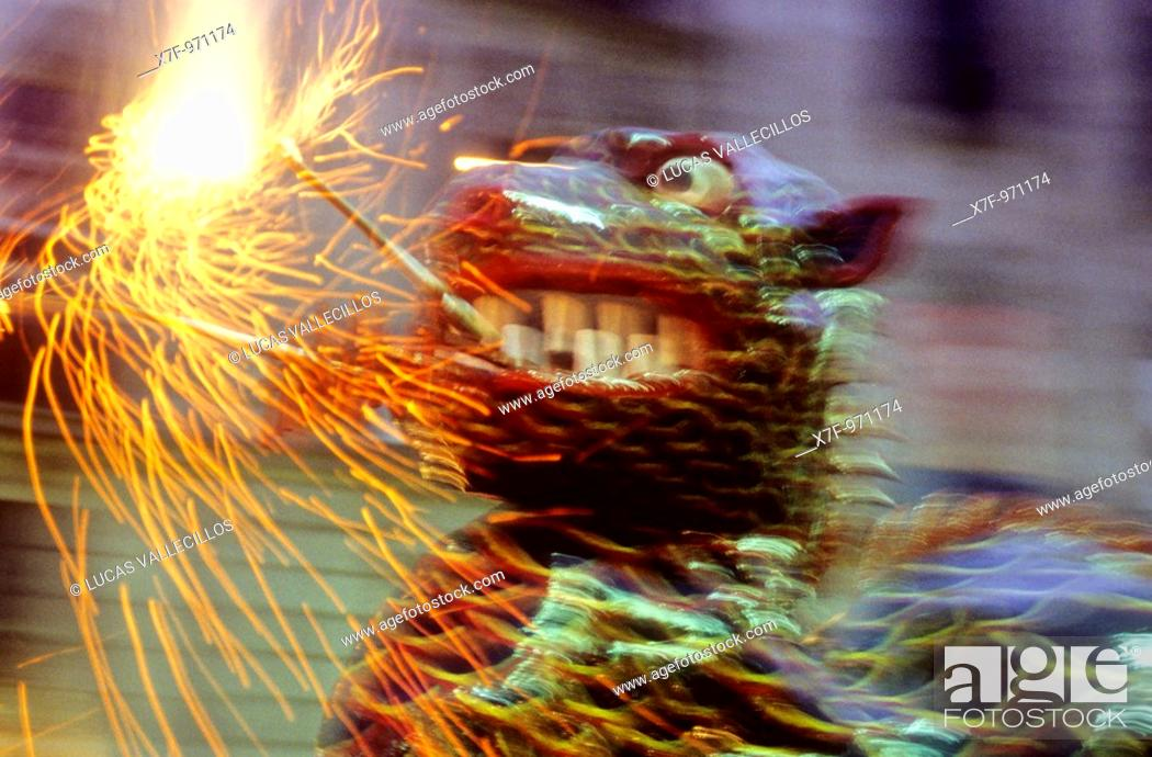Stock Photo: Barcelona: `Correfoc', typical catalan celebration in which dragons and devils armed with fireworks dance through the streets  In las Ramblas during La Merce.