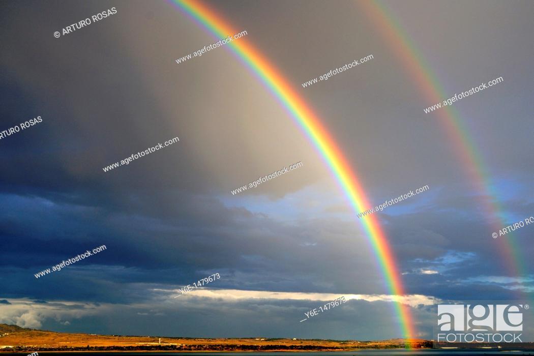 Stock Photo: Double rainbow in Santillana Reservoir  Manzanares el Real Madrid, Spain.