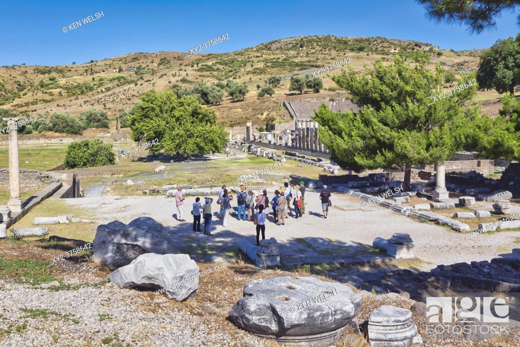 Stock Photo: Asklepieion, also spelled Asclepieion, Asclepion, Asklepion, Asclepeion, near Bergama, Izmir Province, Turkey. A group of tourists visiting the ancient medical.