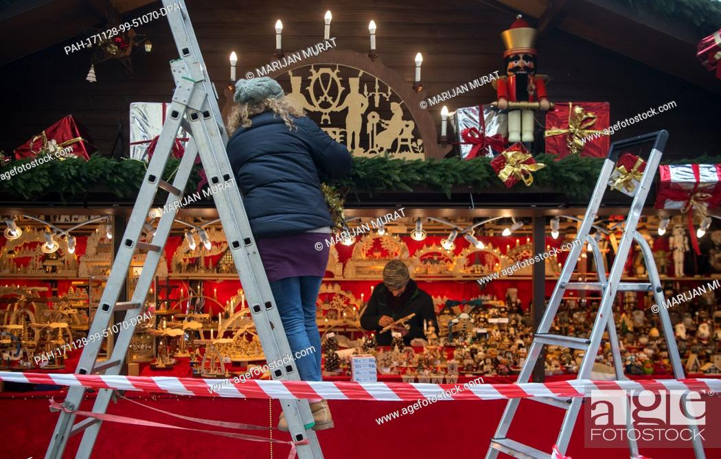 Stock Photo: Christmas market workers decorating their stalls during mounting of the Christmas Market in Stuttgart, Germany, 28 November 2017.