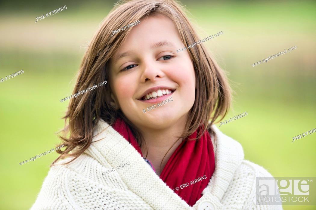 Stock Photo: Girl smiling in a park.