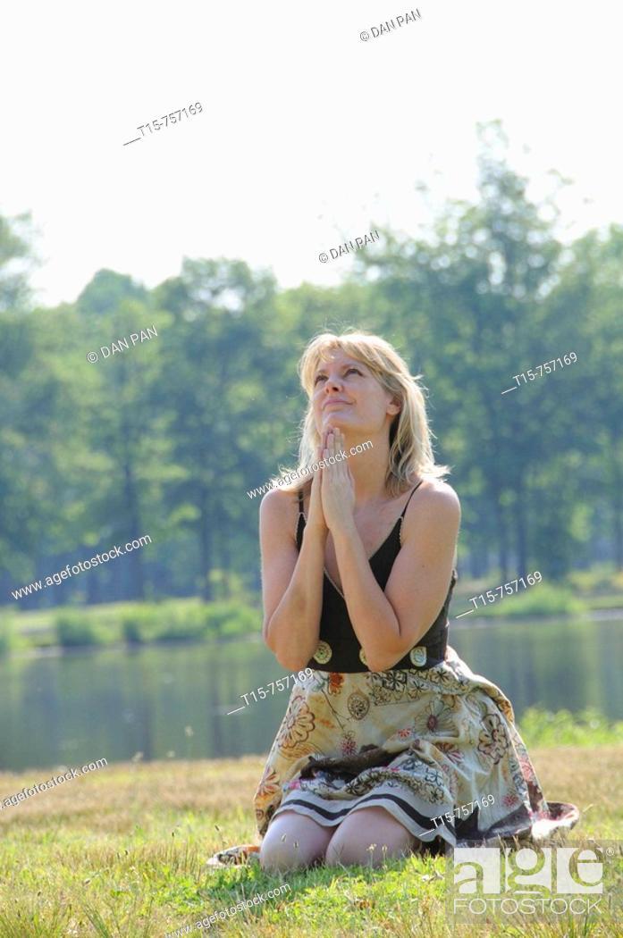 Stock Photo: woman praying.
