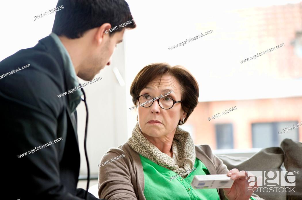 Stock Photo: Male doctor giving medicine to a patient.