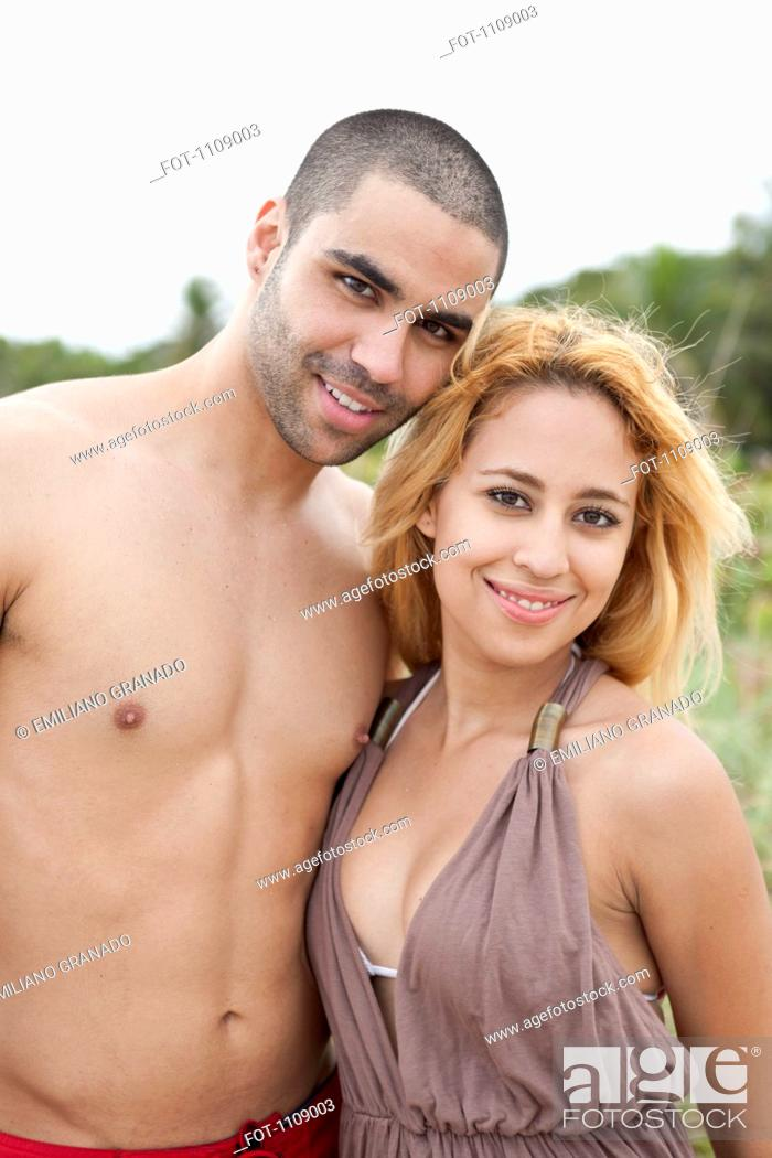 Stock Photo: A young couple posing at the beach.