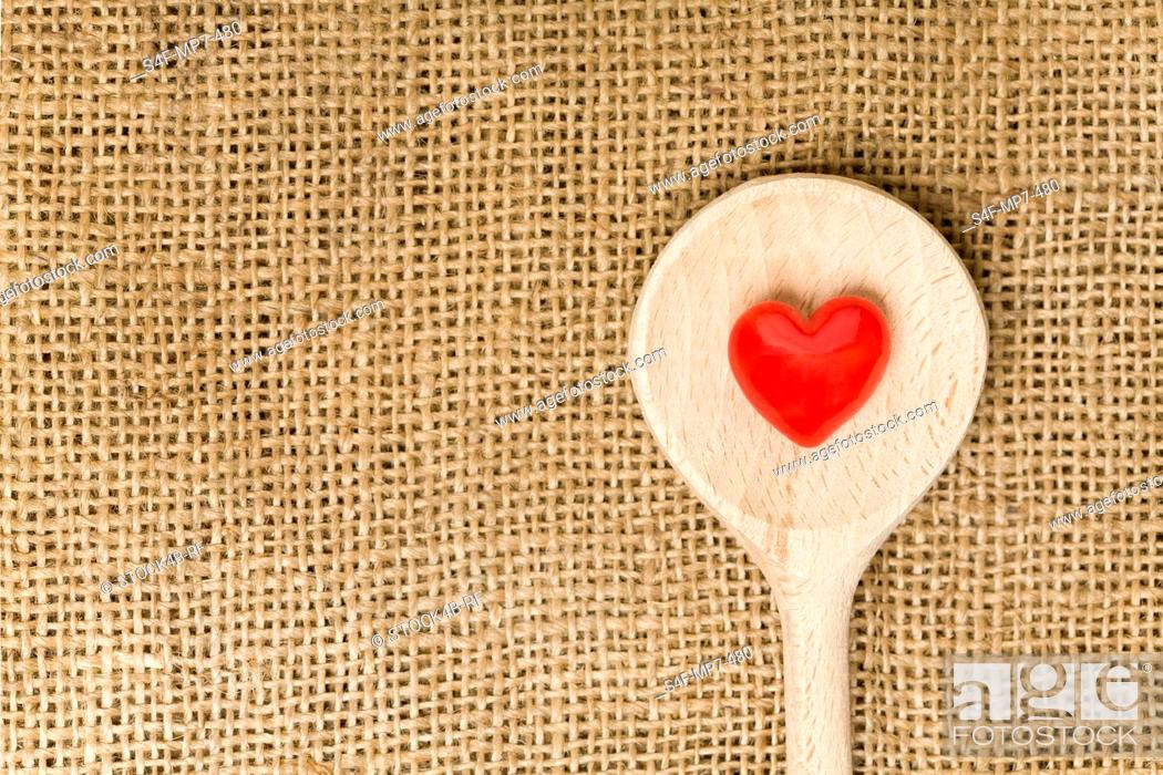 Stock Photo: Red heart on a wooden spoon.