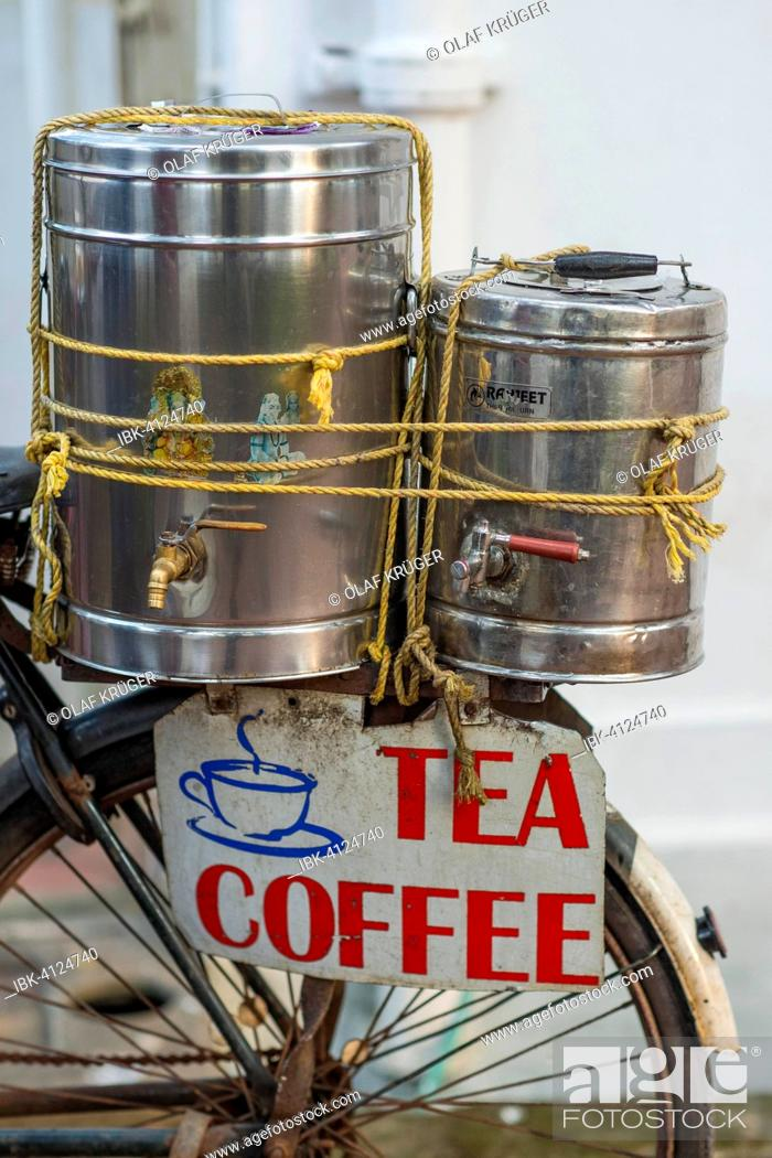 Stock Photo: Sale of coffee and tea, containers for tea and coffee on the luggage rack of a bicycle, Fort Cochin, Kochi, Kerala, India.