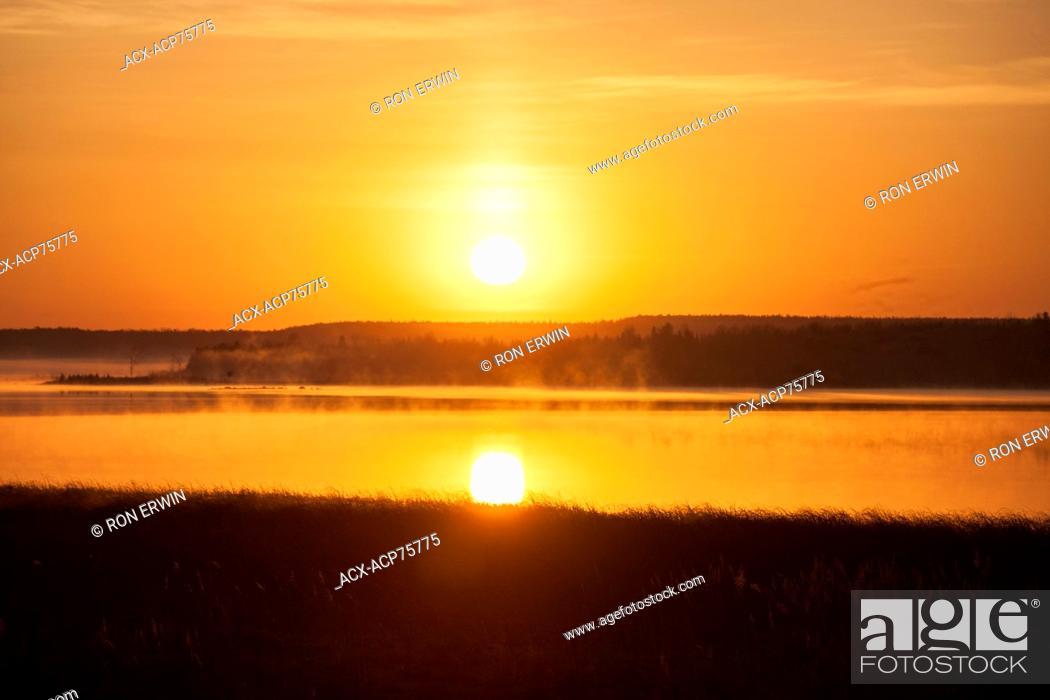 Stock Photo: The rising sun, Barrie Island, Manitoulin Island, Ontario, Canada.