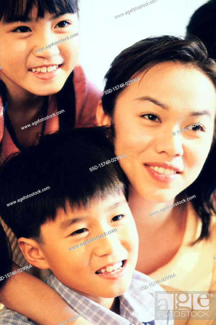 Stock Photo: Close-up of a mother with her two sons.