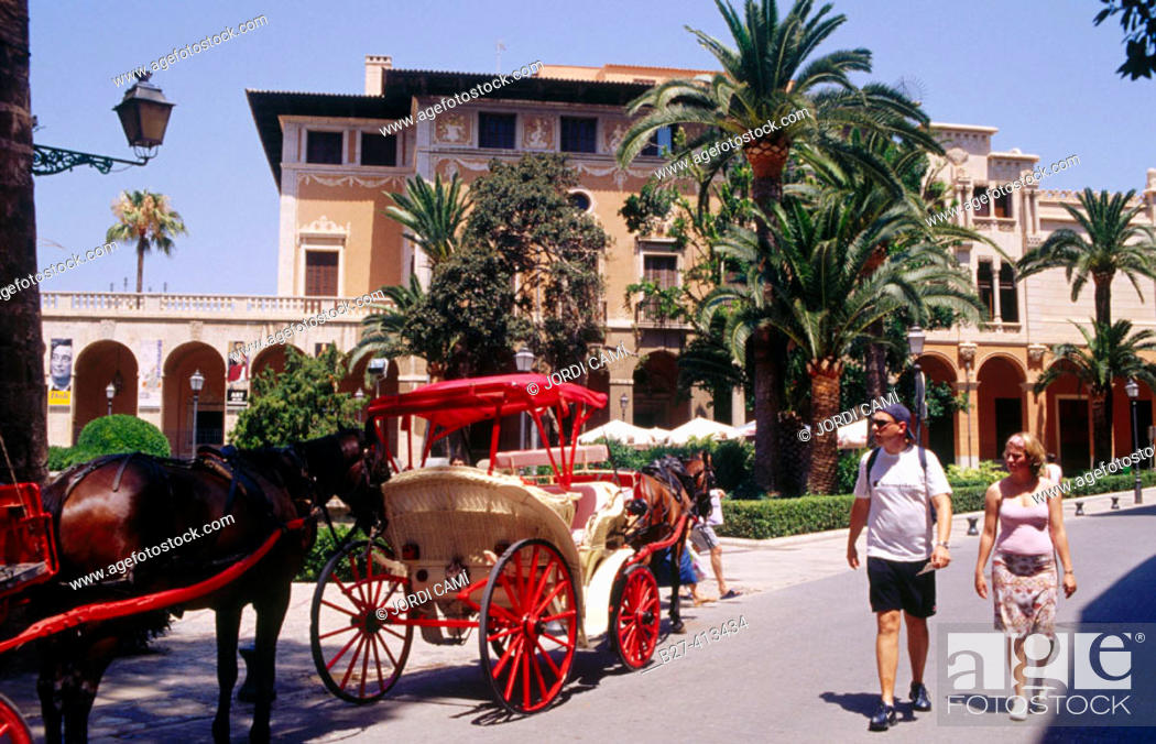 Stock Photo: Carriages for tourists in front of Palau March, Palma de Mallorca. Majorca, Balearic Islands. Spain.