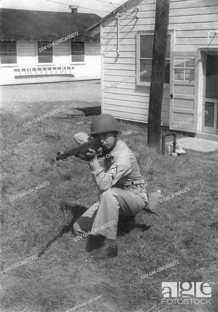 Stock Photo: Soldier Displaying Proper Shooting Position During Training Session, WWII, 2nd Battalion, 389th Infantry, US Army Military Base Indiana, USA, 1942.
