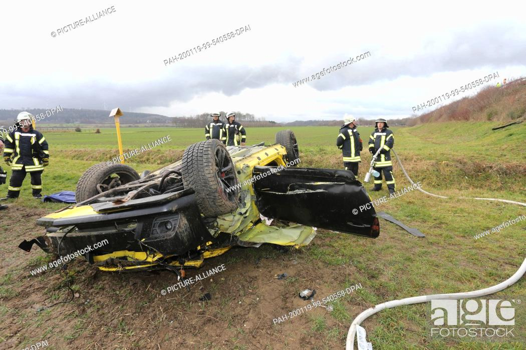 Stock Photo: 19 January 2020, North Rhine-Westphalia, Eschweiler: After a traffic accident on highway 4, firefighters are standing at the scene of the accident.