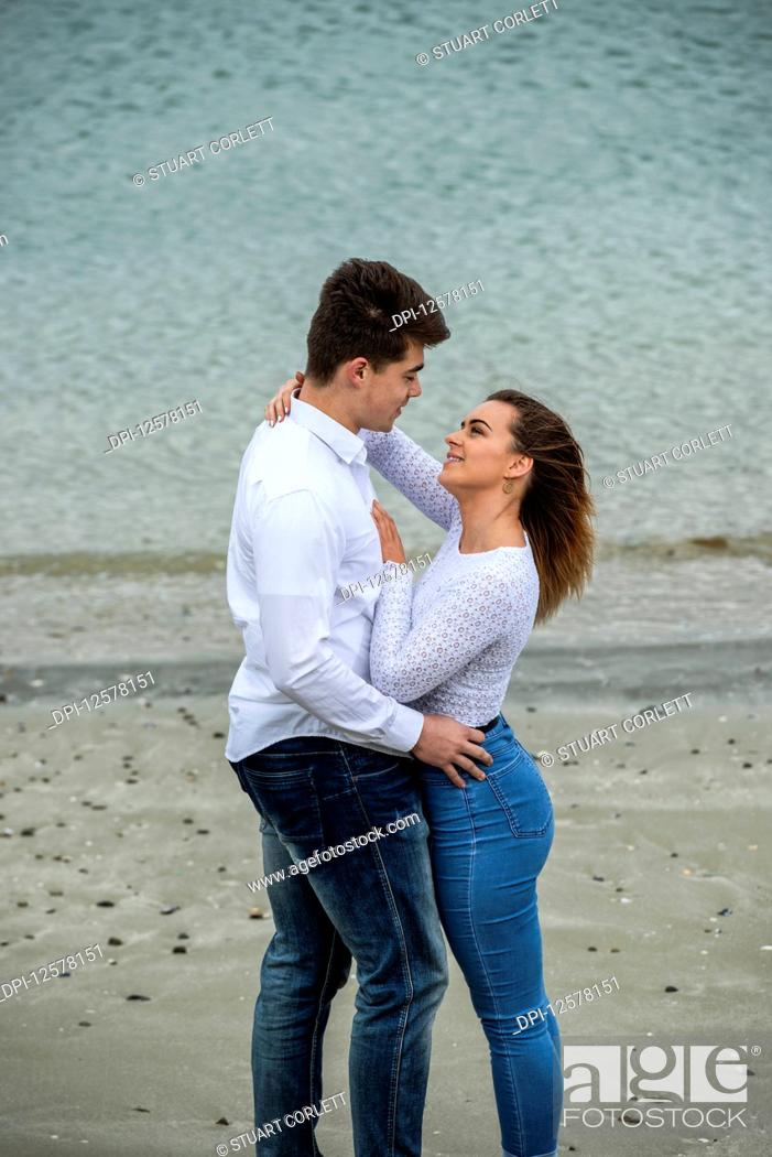 Stock Photo: Portrait of a young couple showing affection; Wellington, North Island, New Zealand.