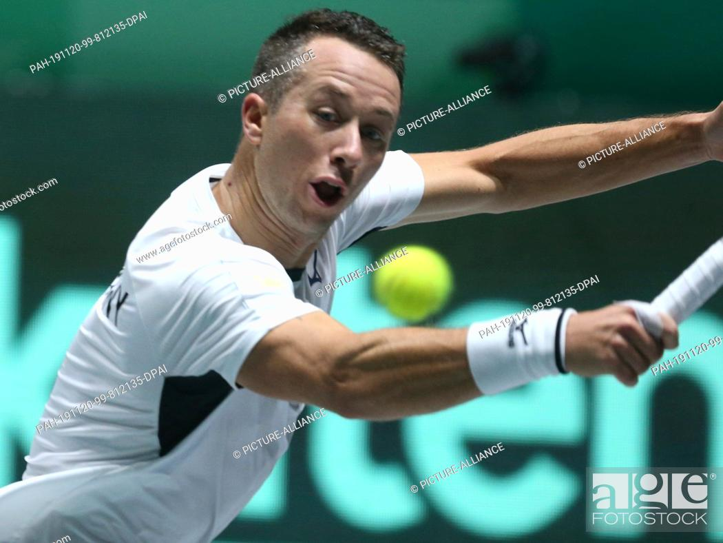 Stock Photo: 20 November 2019, Spain, Madrid: Group C, Argentina - Germany. Single, Pella (Argentina) - Kohlschreiber (Germany). Philipp Kohlschreiber in action.