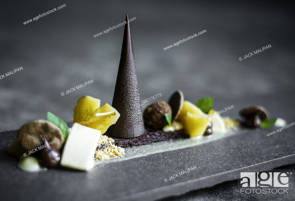 Stock Photo: gourmet modern creative chocolate cake and dried fruit dessert dish on slate.