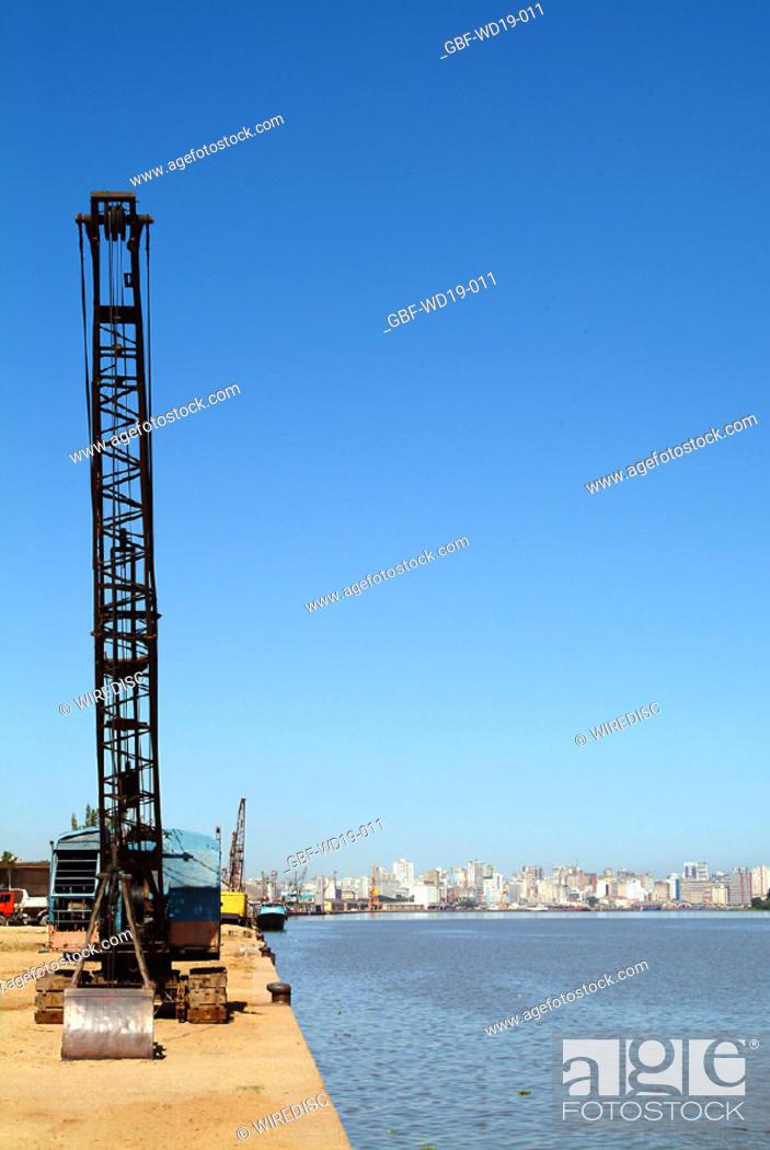 Stock Photo: crane, Rio Guaiba, Rio Grande do Sul, Brazil.