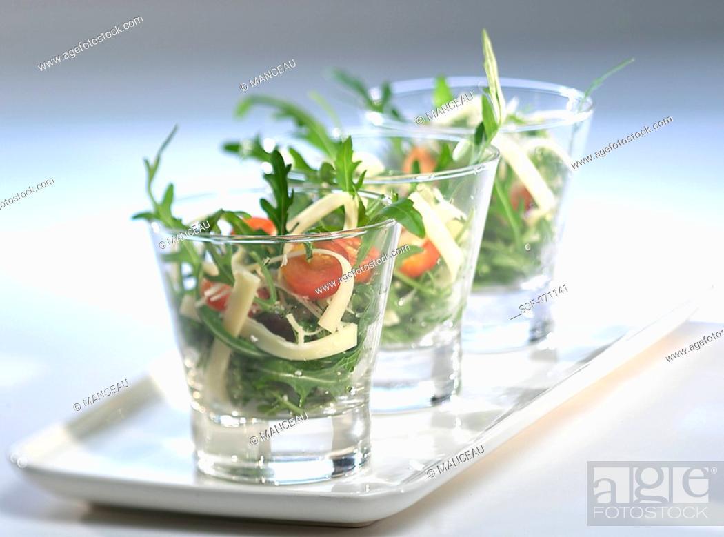 Stock Photo: Rocket,tomato and palm heart salad.
