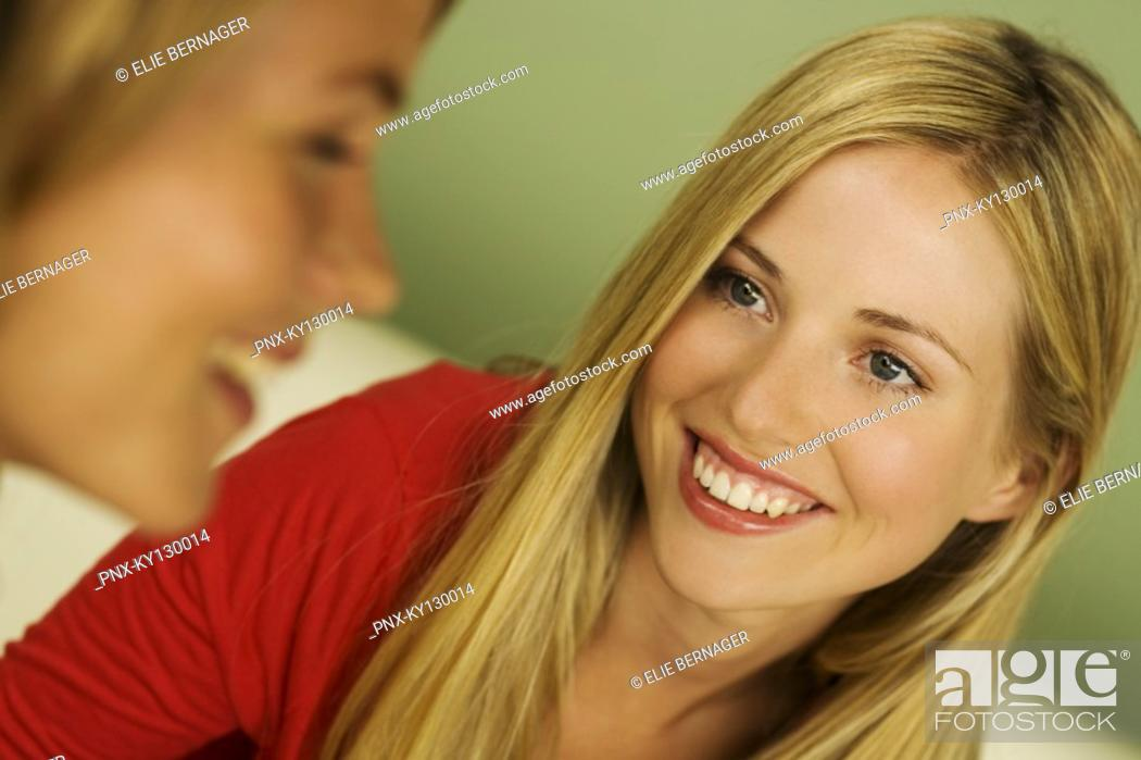Stock Photo: Portrait of 2 young smiling women.