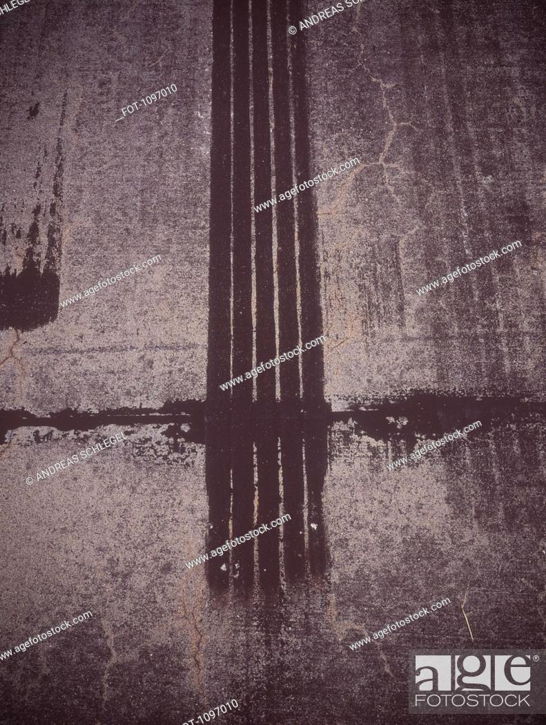 Stock Photo: Tire marks on a road surface.