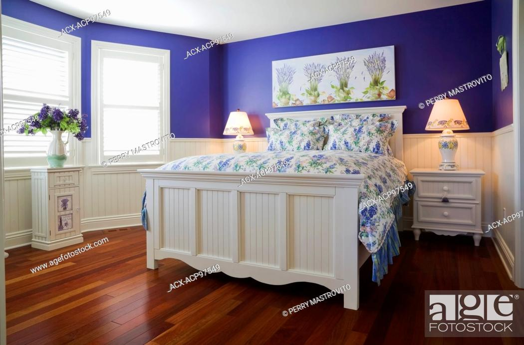 Stock Photo Queen Size Bed With Night Tables In Lavender White Trim Guest Bedroom On The Upstairs Floor Inside An Elegant Cottage Style Home Quebec