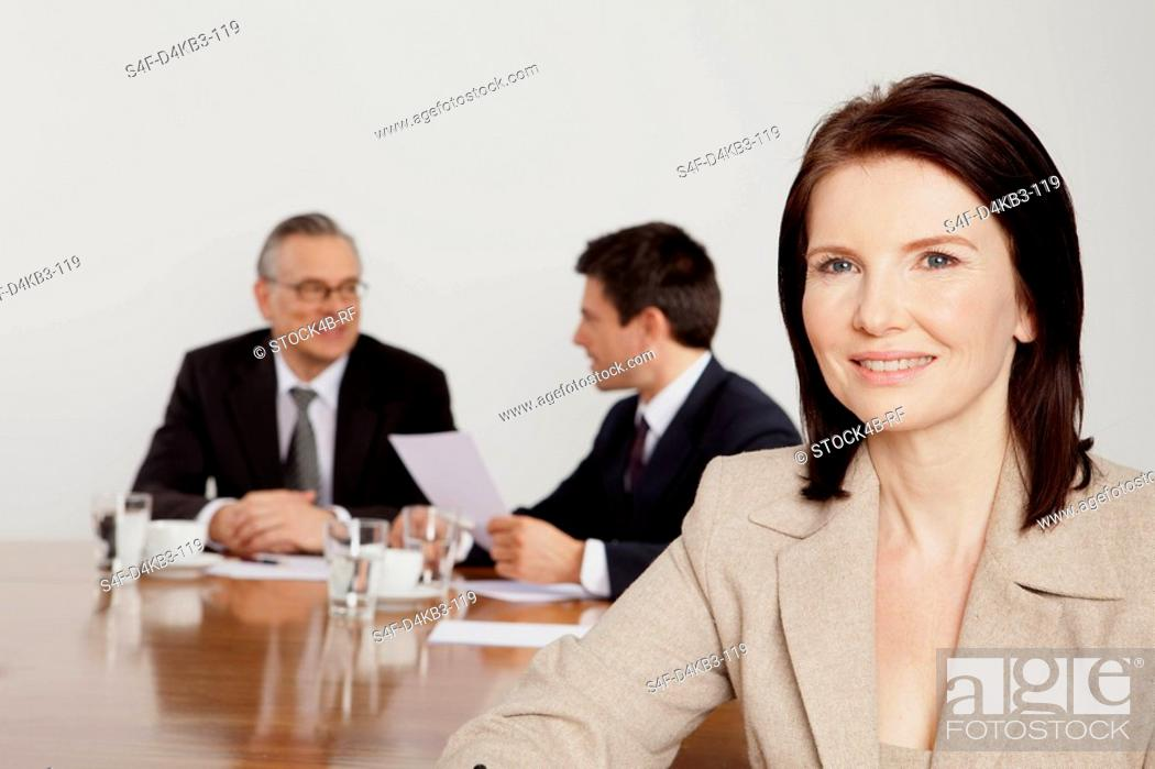 Stock Photo: Three businesspeople in conference room, Bavaria, Germany.