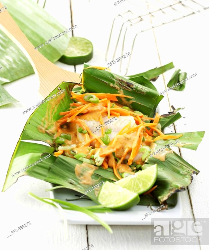 Stock Photo: Nile perch fillet in a banana leaf.