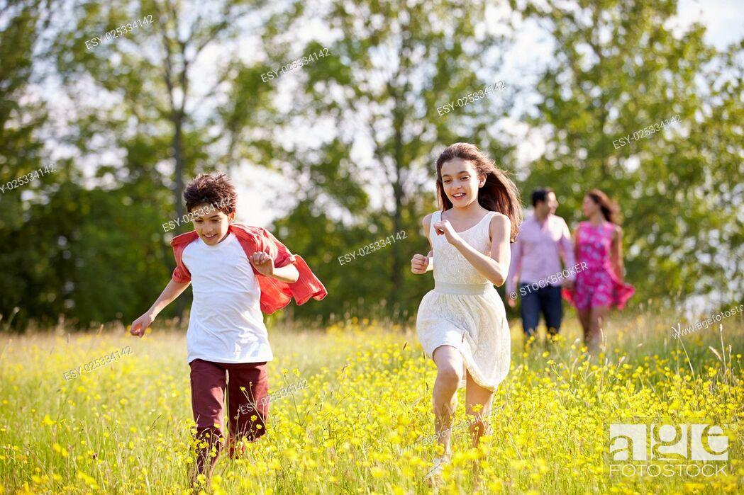 Stock Photo: Hispanic Family Walking In Countryside.
