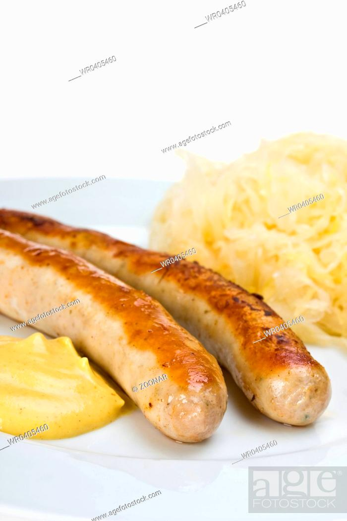 Stock Photo: fried sausages,mustard and sauerkraut.