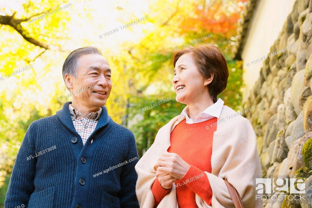 Stock Photo: Senior Japanese couple relaxing in a traditional park in Autumn.