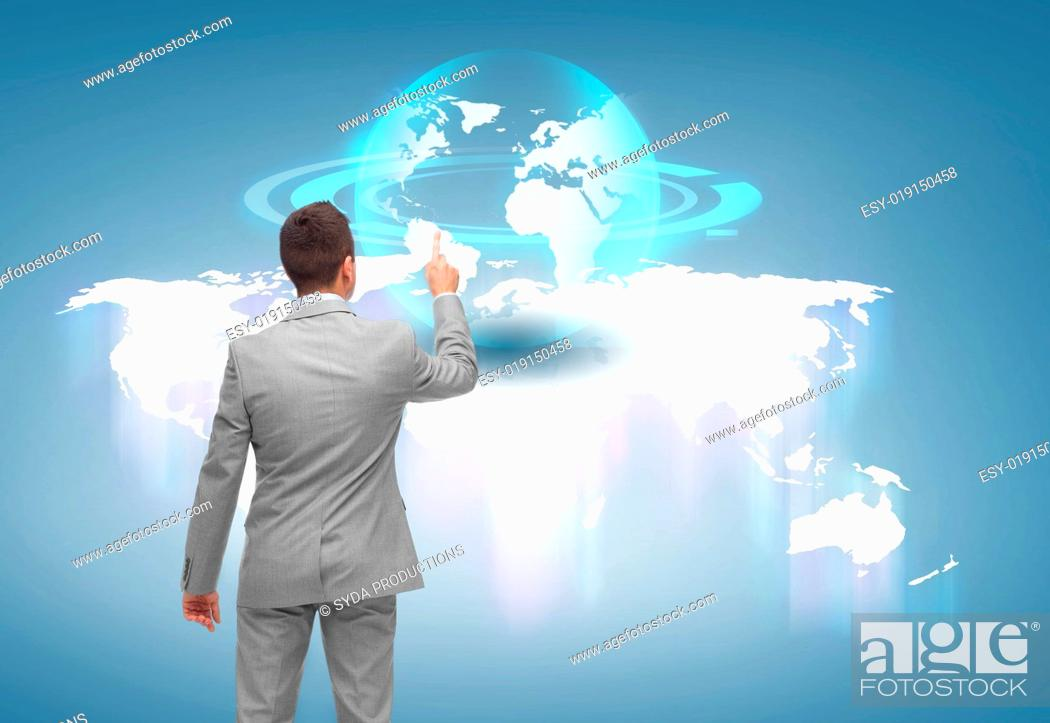 Stock Photo: business, people and technology concept - businessman pointing finger or touching virtual globe projection over blue background from back.
