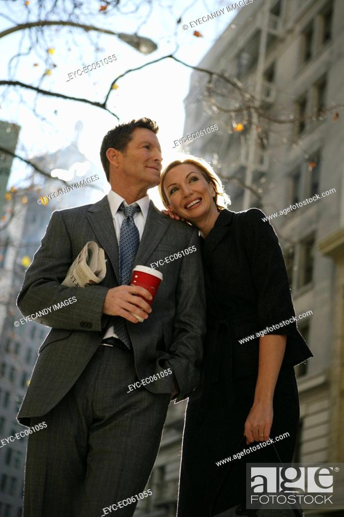 Stock Photo: Couple standing in the street.