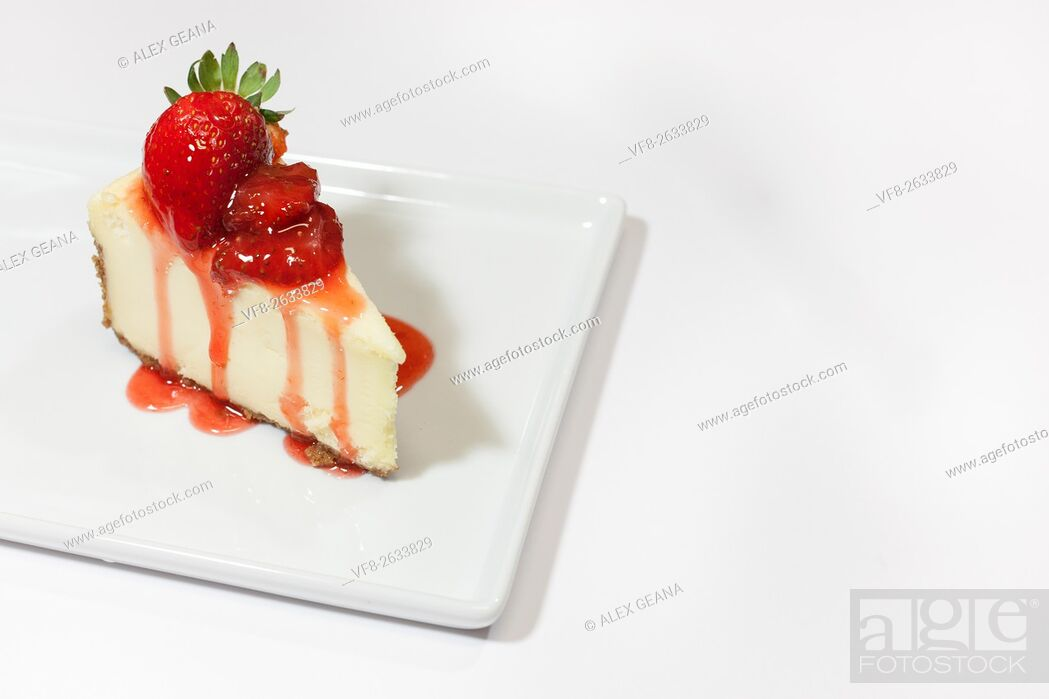 Stock Photo: A white cheesecake with dripping strawberry sauce and a graham cracker crust, garnished with whole strawberries on a square plate.