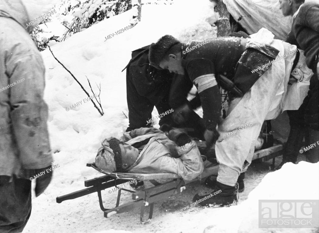 Wounded soldier tended in the field and prepared for