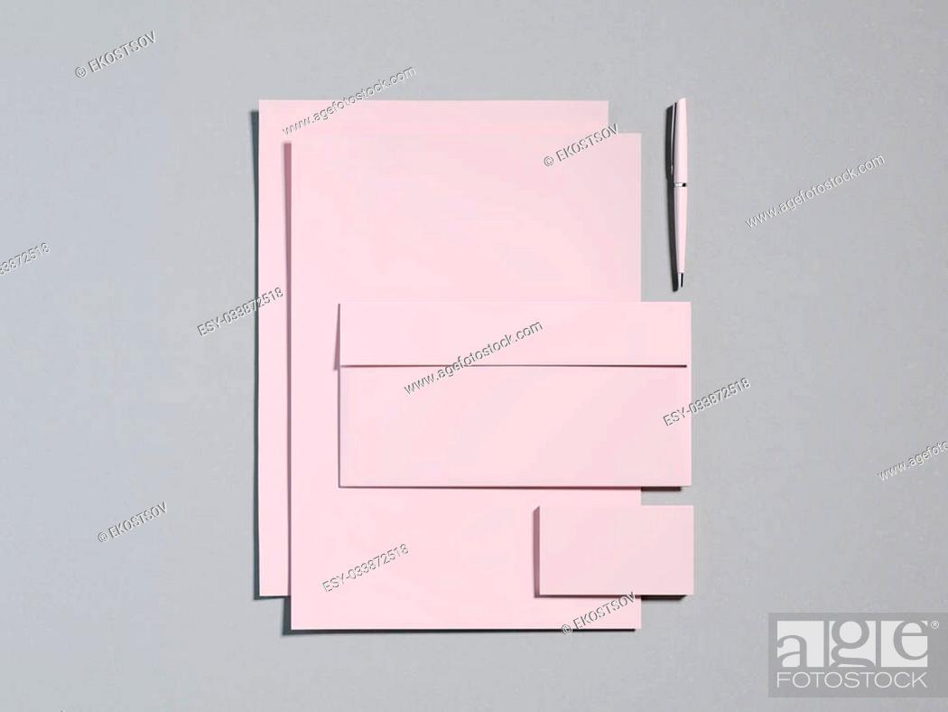 Stock Photo: Pink branding mockup on a gray background.