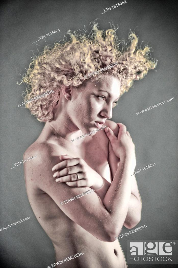 Stock Photo: Blonde woman with flying curly hair topless.