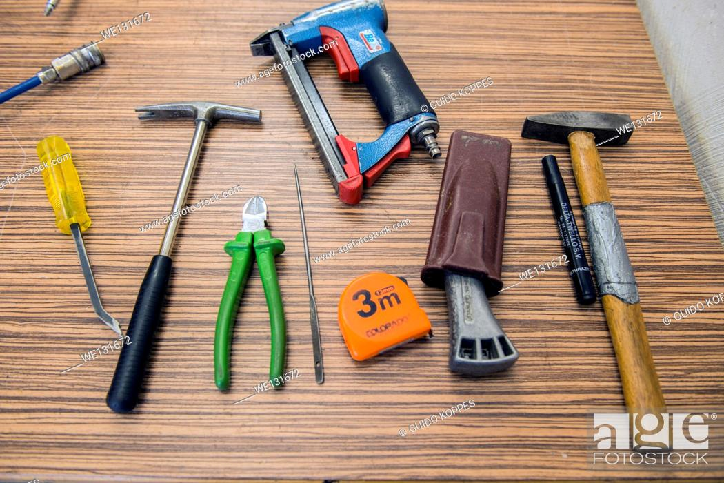 Stock Photo: Tilburg, Netherlands. Tools organized neatly on a workbench in the workshop of a furniture upholstery.