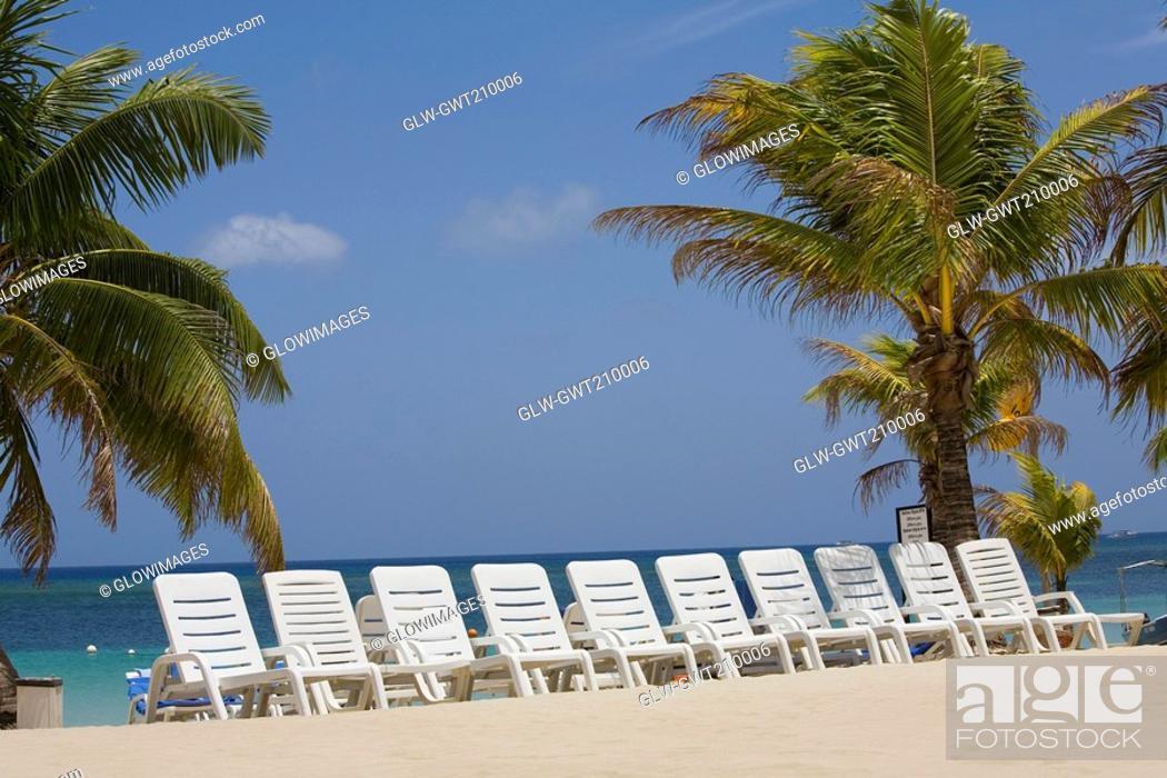 Stock Photo: Beach chairs on the beach, Roatan, Bay Islands, Honduras.