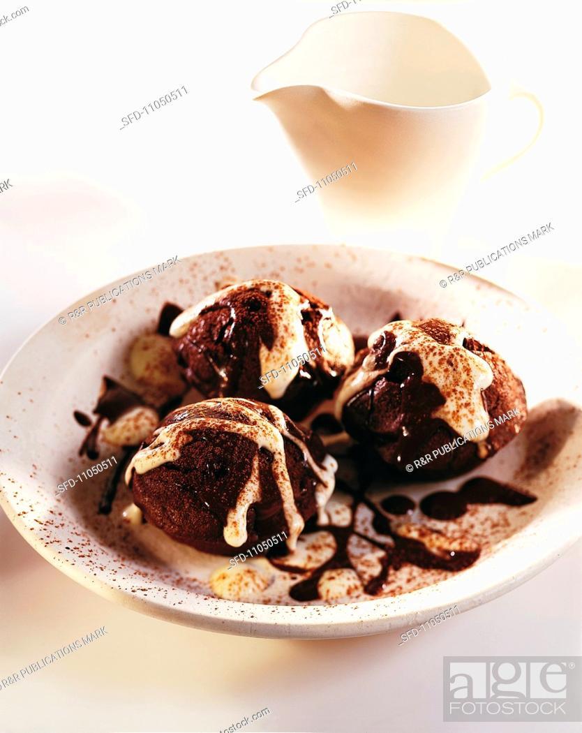 Stock Photo: Chocolate muffins with mocha sauce.