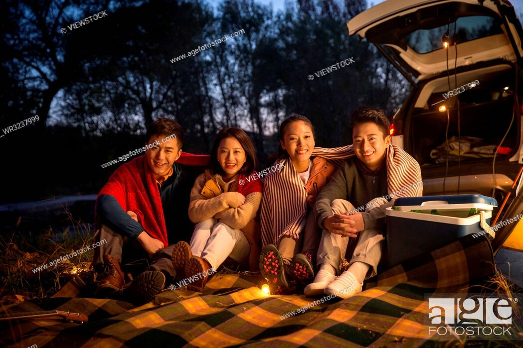 Stock Photo: Young men and women in the outdoor camping.