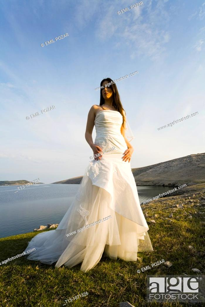 Stock Photo: Beautiful bride standing in late afternoon light.