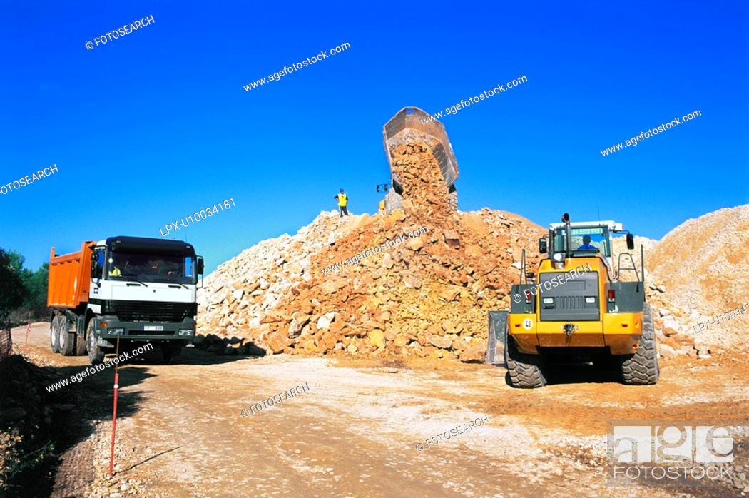 Stock Photo: Excavator and dumptruck on a road building site.
