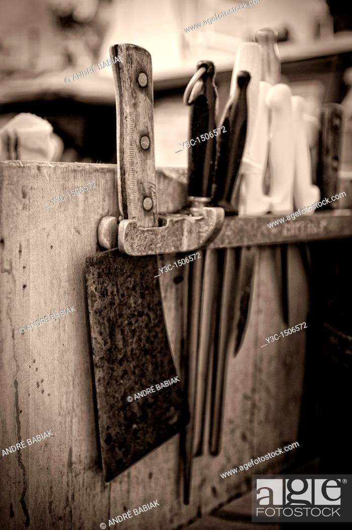 Stock Photo: Butcher shop knife rack.