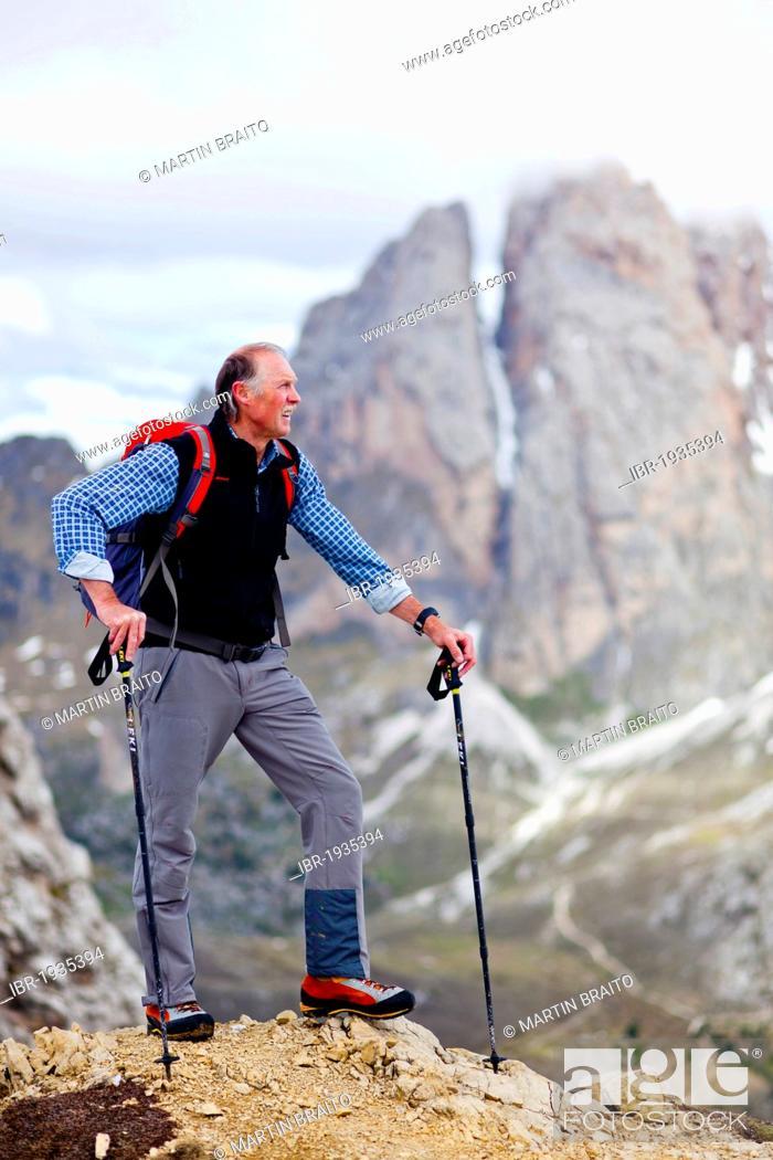 Stock Photo: Climber on the Pizzascharte wind gap, Dolomites, Geisler or Odle group at the back, Fermedatuerme peaks, province of Bolzano-Bozen, Italy, Europe.
