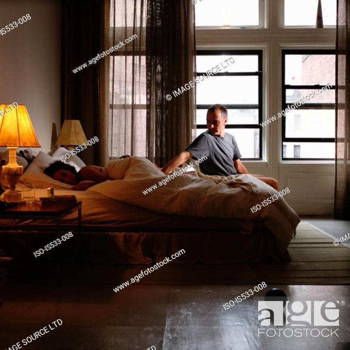 Stock Photo: Couple resting on bed.