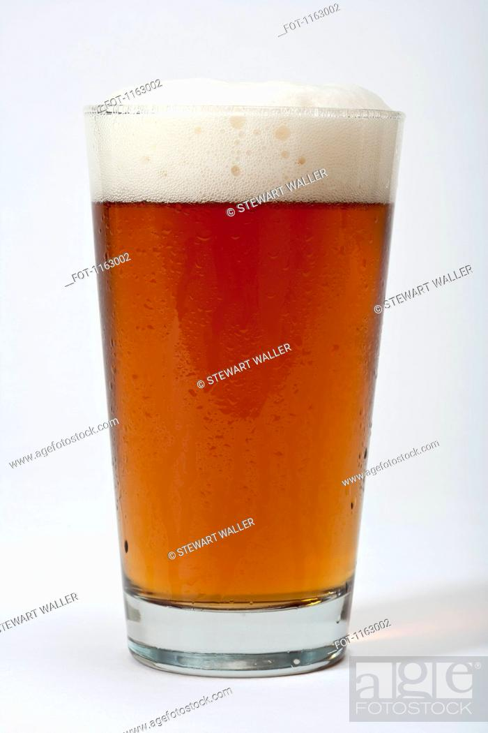 Stock Photo: Pint of frothy beer.