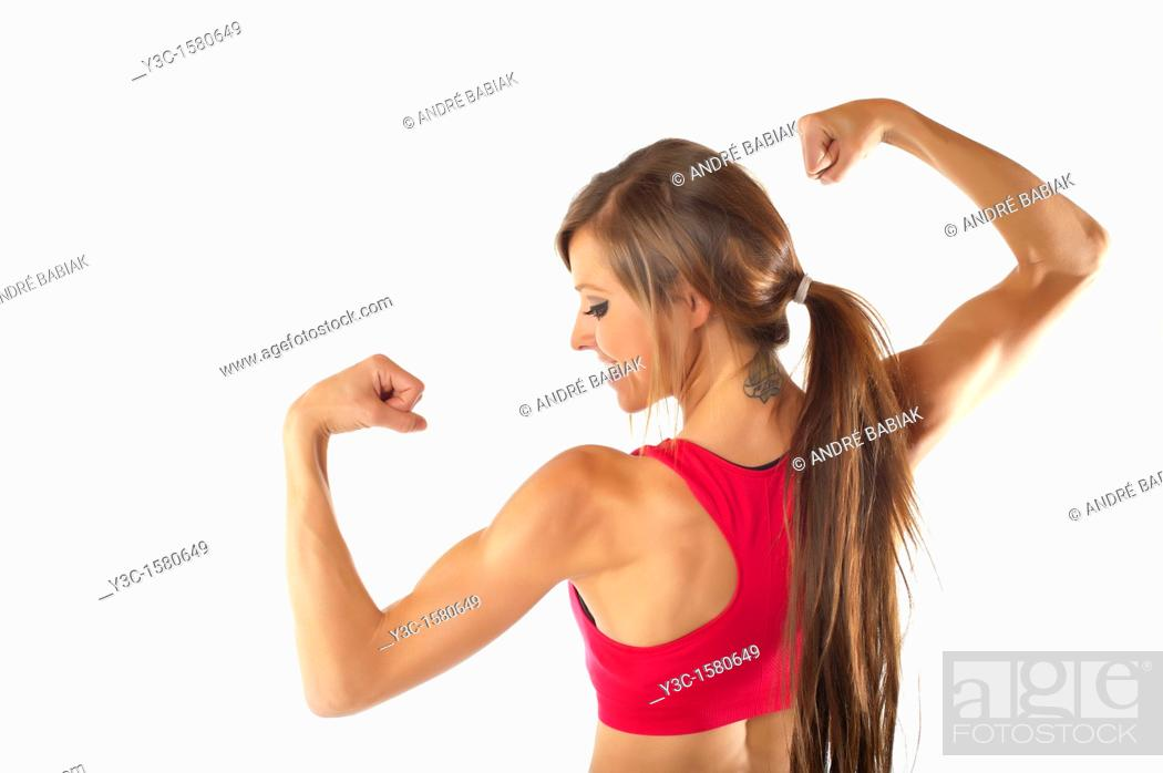 Stock Photo: Young woman body building.