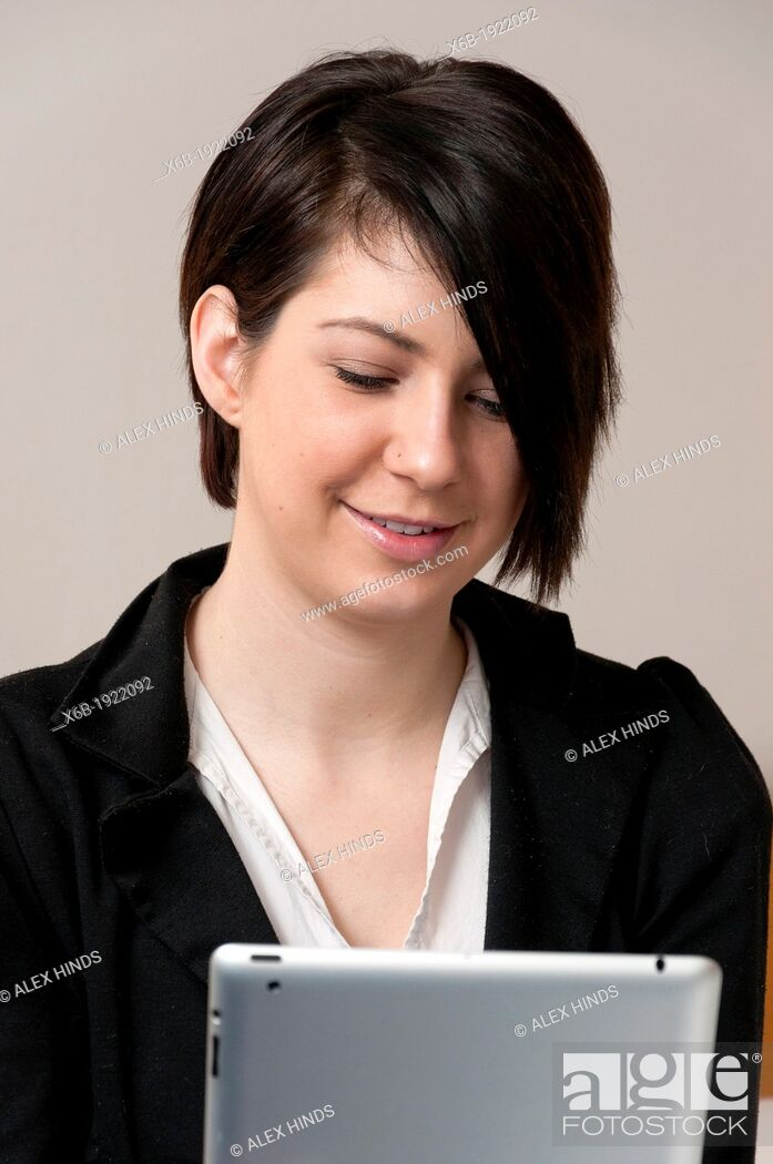 Stock Photo: Young woman using ipad tablet computer.