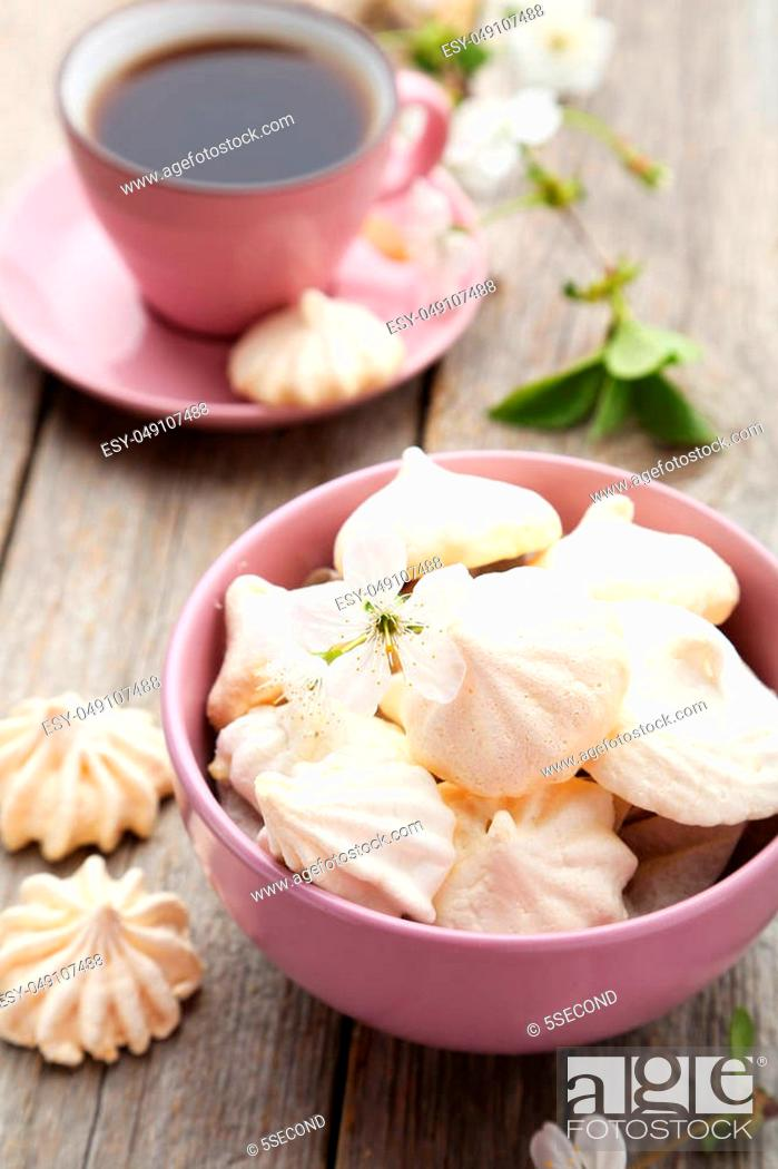 Stock Photo: French meringue cookies in bowl on grey wooden background.