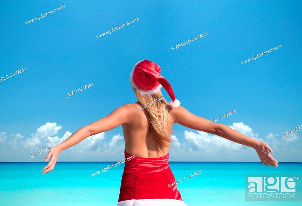 Stock Photo: Woman with Santa's hat on the beach, Miami, Florida, USA.